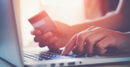 Hands,Holding,Credit,Card,And,Using,Laptop.,Online,Shopping